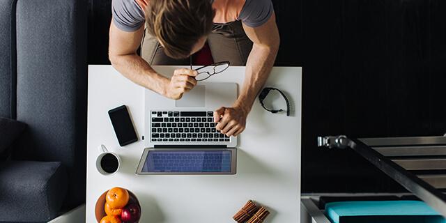Overhead of freelancer at laptop