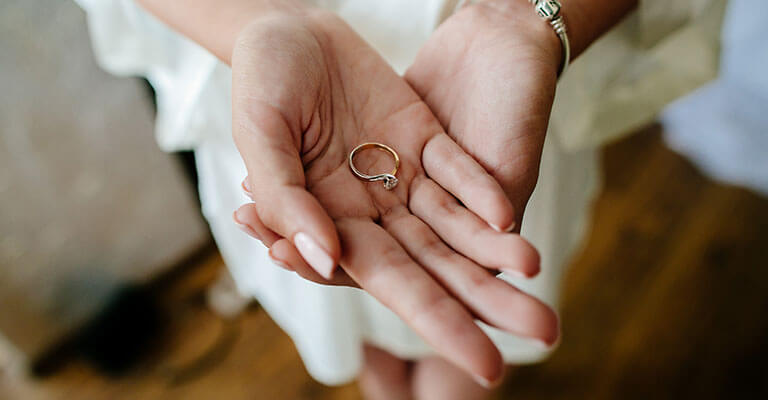 Woman's hands holding engagement ring