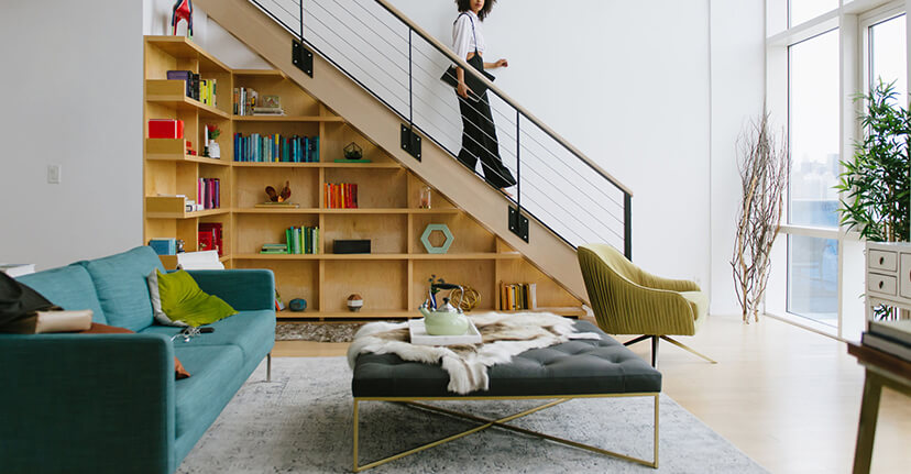 Woman on bookshelf staircase
