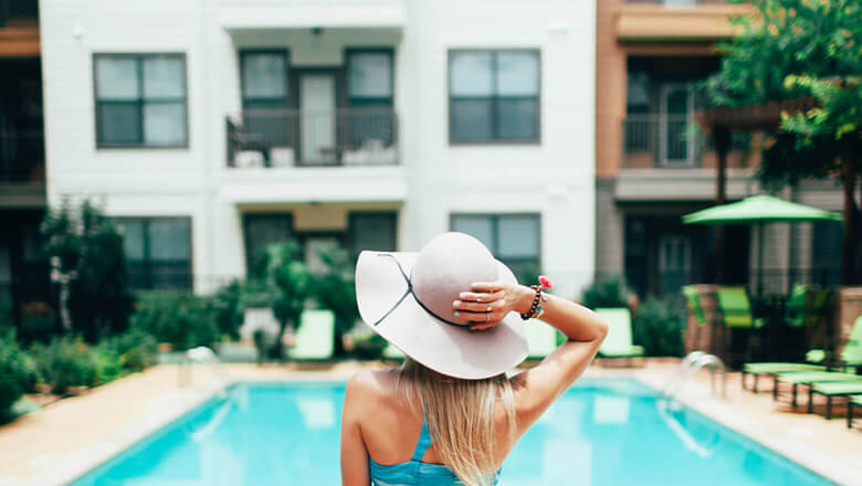 woman on vacation at the pool