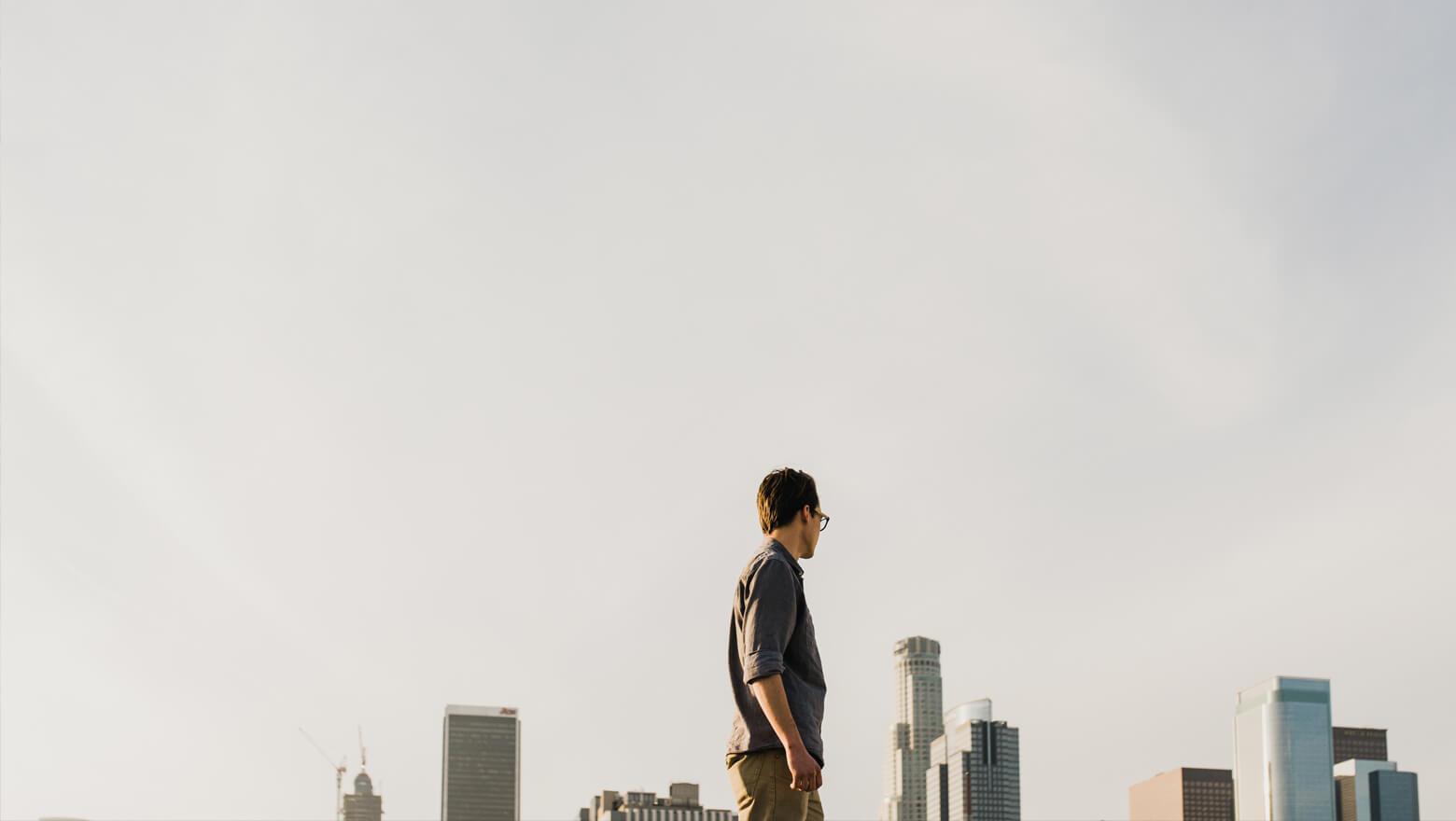 Man looking toward city