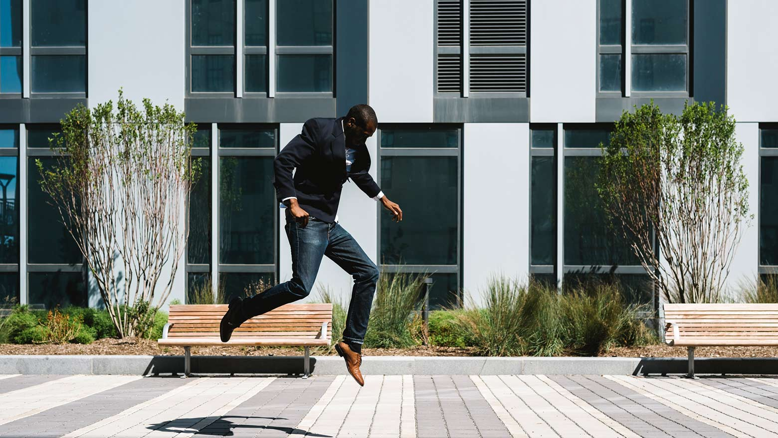 businessman jumping outside