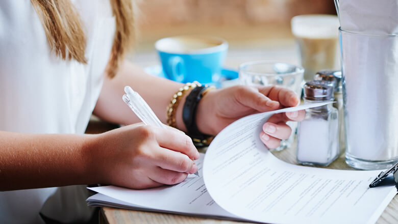 woman signing papers