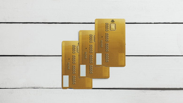 gold credit cards on wood background