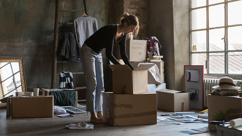 woman unpacking boxes