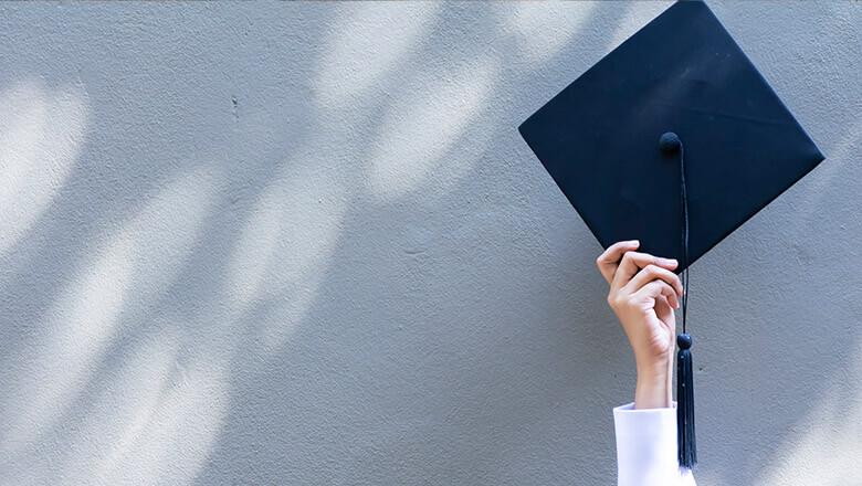 graduation cap on gray wall