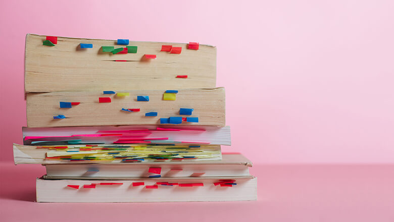 Books with sticky note markers