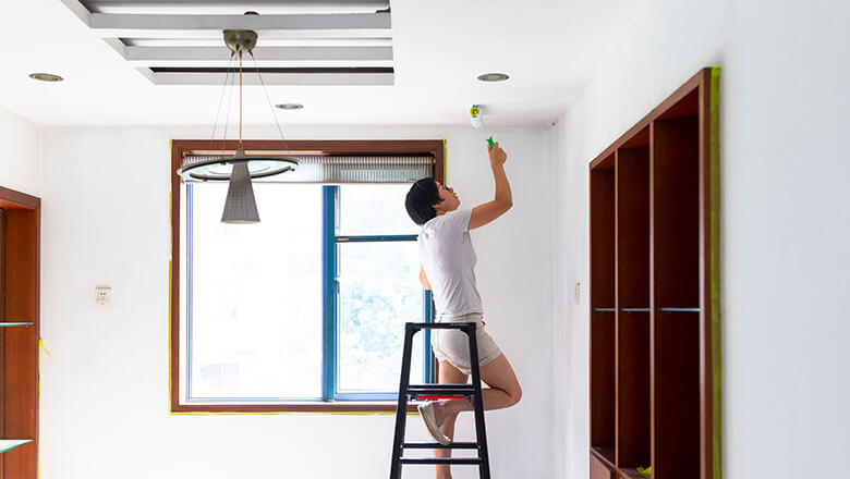 woman painting her ceiling