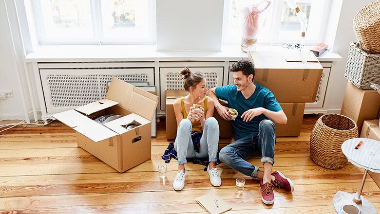 man and woman on floor unpacking