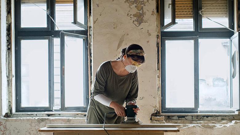 Woman renovating house