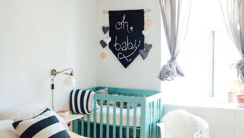 turquoise crib in nursery