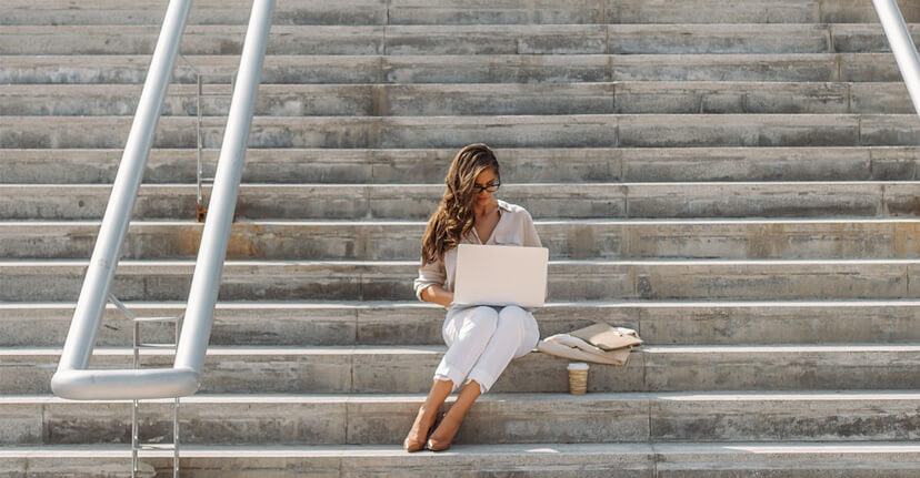 woman on stairs with laptop