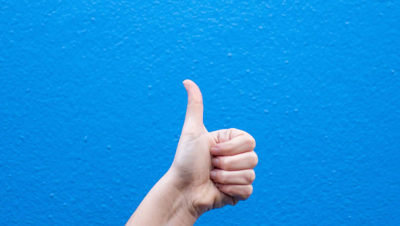 thumbs up blue background