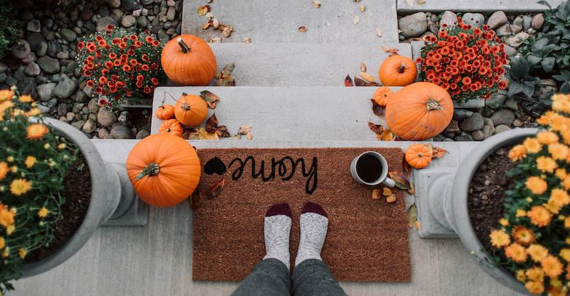 fall doormat and pumpkins