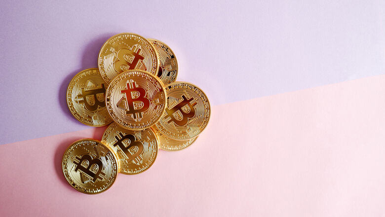 bitcoins on purple and pink background