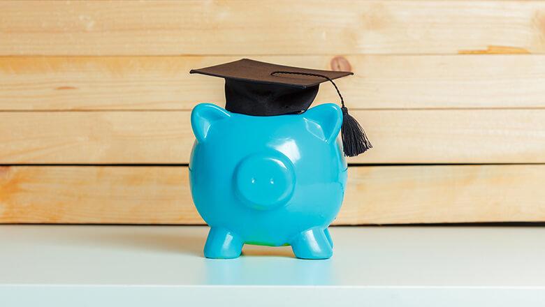 blue piggy bank with graduation cap