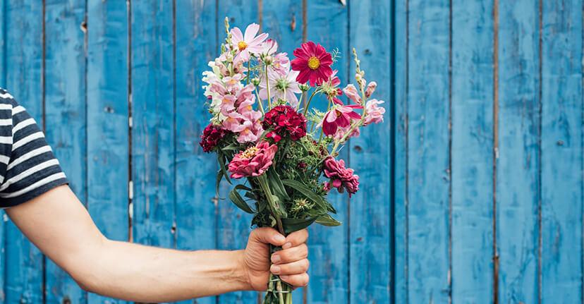 arm holding bouquet