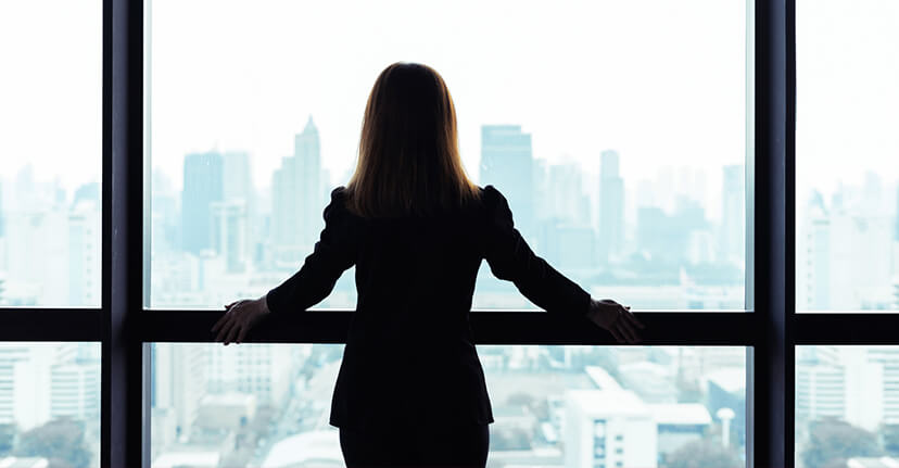 businesswoman looking out woman