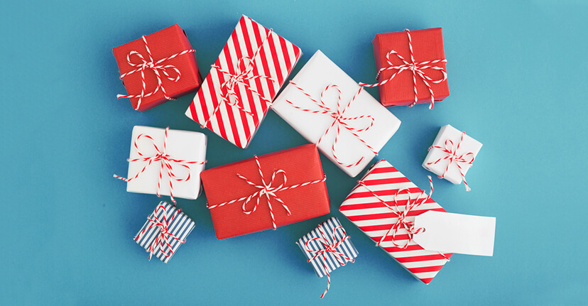 red holiday gifts on blue background
