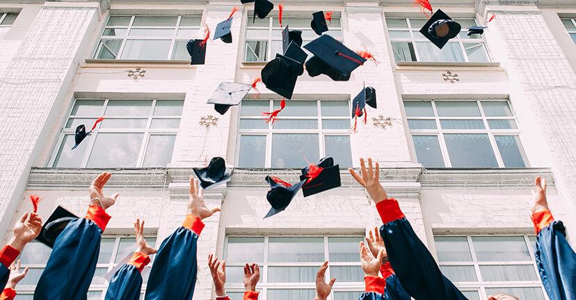 Grads throwing caps