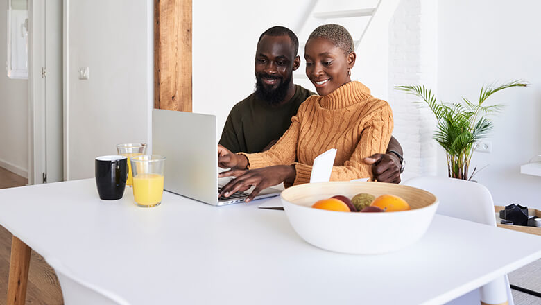 couple home on laptop
