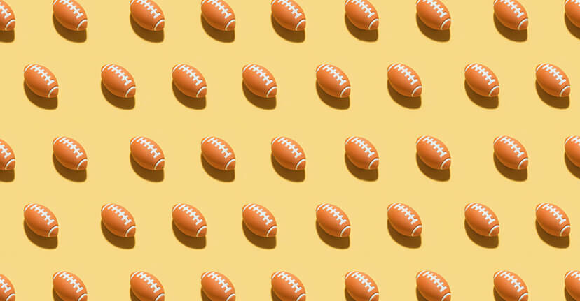 footballs on yellow background