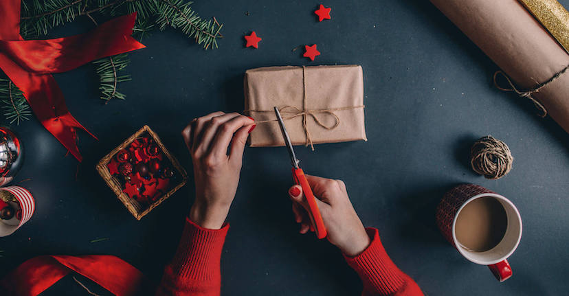 hands wrapping holiday gift