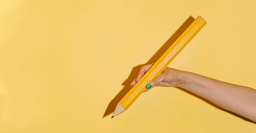 large pencil on yellow background