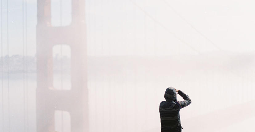 man taking photo of golden gate bridge
