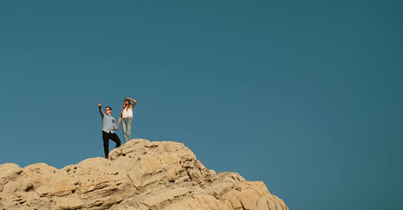 Couple holding hands in desert