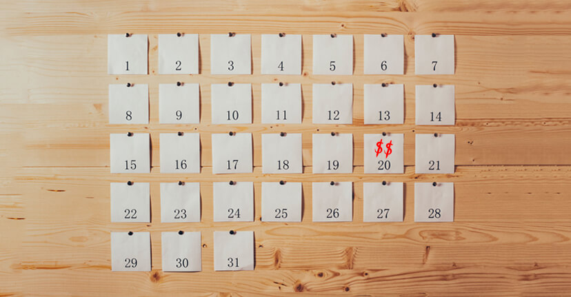 Post-it calendar on wooden surface