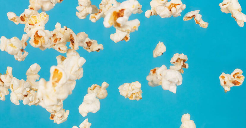 popcorn on blue background