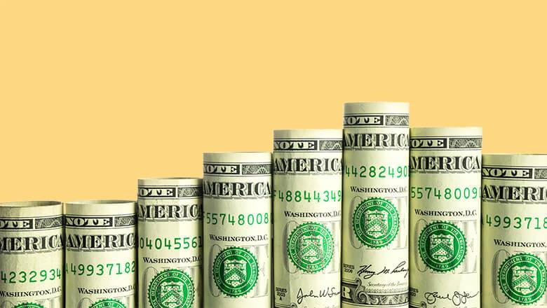 rolled dollar bills