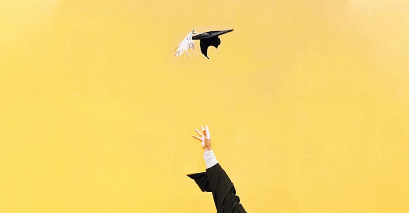 arm throwing up graduation cap