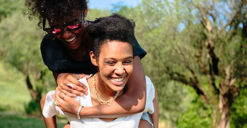 woman giving sibling piggyback