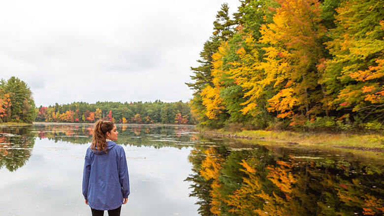 woman at lake in fall