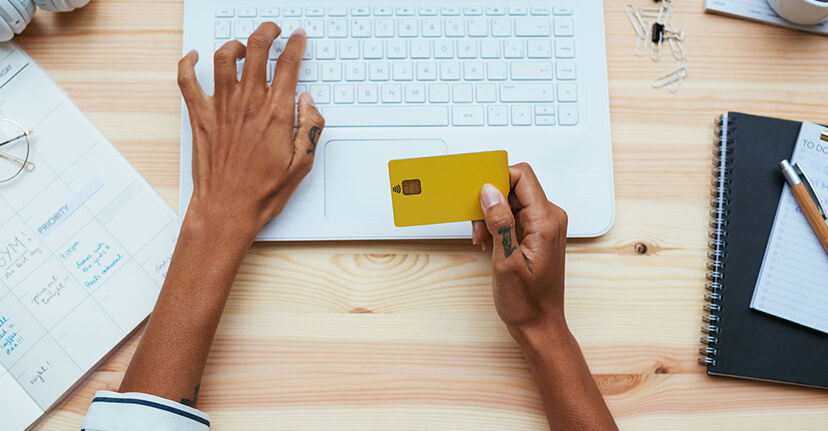 woman with credit card on laptop