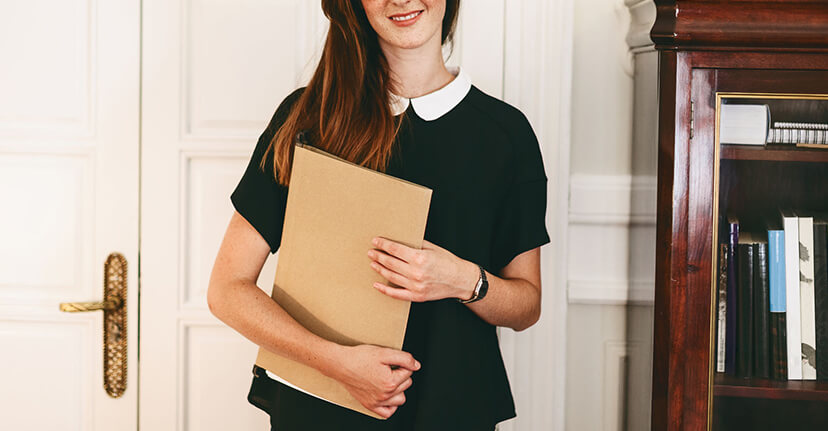woman with folder in office