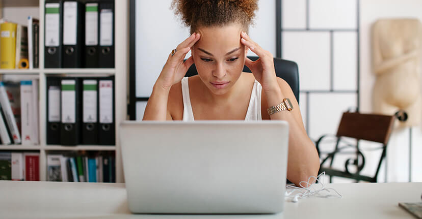 stressed woman with laptop