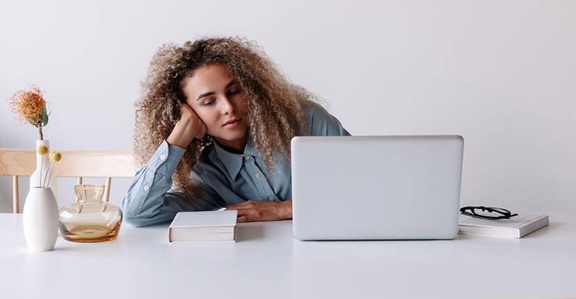 tired woman on laptop