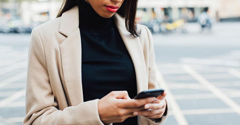 Woman on smartphone on street